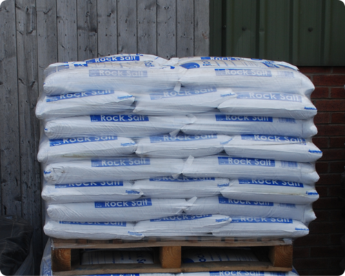 Small 25kg Bags of Brown De-icing rock salt on a pallet